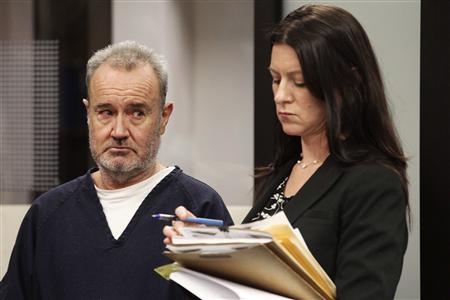 Peter Robbins (L), the former voice of Charlie Brown on animated TV specials and movies, reacts as he is sentenced to probation in San Diego, California May 8, 2013 on charges that he stalked and threatened a former girlfriend and La Jolla plastic surgeon. Kristin Scogin, his attorney, looks on. REUTERS/John Gibbins/Pool