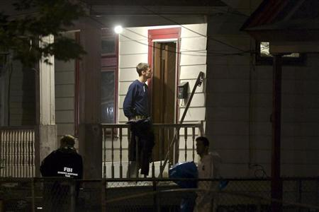 FBI agents search the home where three Cleveland women were found alive after vanishing in Cleveland, Ohio, May 7, 2013. REUTERS/John Gress