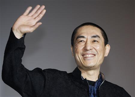 Chinese director Zhang Yimou waves as he poses for the media during a news conference for his opening film ''Under the Hawthorn Tree'' at the 15th Pusan International Film Festival in Busan, about 420 km (261 miles) southeast of Seoul, in this October 7, 2010 file photo. REUTERS/Jo Yong-Hak/Files