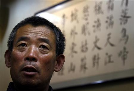 Chen Guangfu, the eldest brother of blind Chinese activist Chen Guangcheng, recounts in Beijing May 23, 2012 the details of his torture and the authorities' reprisals against his family after Chen Guangcheng's flight last week to the United States. REUTERS/David Gray