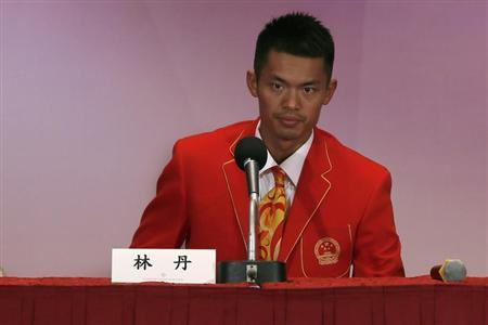 China's badminton player Lin Dan attends a news conference in Hong Kong August 24, 2012. REUTERS/Tyrone Siu