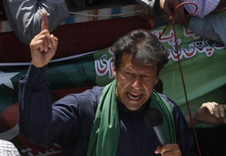 Imran Khan, Pakistani cricketer-turned-politician and chairman of political party Pakistan Tehreek-e-Insaf (PTI), addresses his supporters after his visit to mausoleum of Mohammad Ali Jinnah, founder and first governor-general of Pakistan, during an election campaign in Karachi May 7, 2013. Pakistan's general election will be held on May 11. REUTERS/Athar Hussain