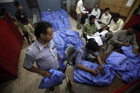 Officials from the Election Commission of Pakistan prepare sacks of stationery materials, before they are transported to polling offices, in the premises of the district city court in Karachi May 8, 2013. REUTERS/Athar Hussain
