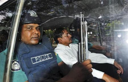 Mohammad Kamaruzzaman (C), assistant secretary general of the Jamaat-e-Islami party, sits inside a police van after hearing the verdict of his trial in front of the International Crimes Tribunal-2 in Dhaka May 9, 2013. REUTERS/Khurshed Rinku