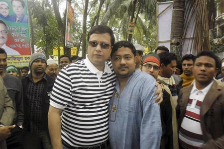 Towhid Jung Murad (centre L), local parliamentarian from the ruling Bangladesh Awami League posses for photos with Sohel Rana, the owner of Rana Plaza building, after a rally by pro-government activist in Savar December 11, 2012. REUTERS/Stringer/Files