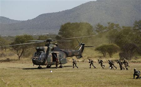 Members of the South African Air Force (SAAF) and army take part in a Capability Demonstration at the Roodewal Bombing Range in Makhado, in the northern province of Limpopo, May 9, 2013. REUTERS/Siphiwe Sibeko