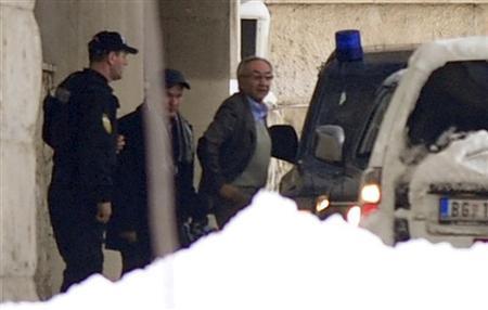 Serbian police officers detain Miroslav Miskovic (R), a billionaire retail tycoon, in Belgrade December 12, 2012. REUTERS/Stringer