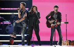 "Charles Kelley (L), Hillary Scott and Dave Haywood of Lady Antebellum perform the song ""Downtown"" during the 48th ACM Awards in Las Vegas April 7, 2013. REUTERS/Mario Anzuoni"