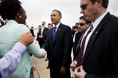 U.S. President Barack Obama (C) greets well wishers as he arrives in Austin, Texas, May 9, 2013. REUTERS/Joshua Roberts