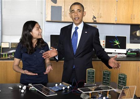 U.S. President Barack Obama speaks during a demonstration of solar powered models by a student at Manor New Tech High School in Austin, Texas, May 9, 2013. REUTERS/Joshua Roberts