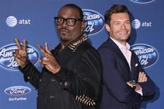 Musician and producer Randy Jackson (L) and TV and radio personality Ryan Seacrest arrive for the American Idol Season 12 premiere event at Royce Hall at University of California Los Angeles, in Los Angeles, California, January 9, 2013. REUTERS/Jonathan Alcorn