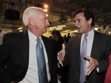 Kentucky Governor Steve Beshear (L) talks with Ford Motor Company's Mark Fields (R), Ford's president of the Americas, during a news conference to celebrate the start of production of Ford's new 2013 Ford Escape at the company's transformed Louisville Assembly Plant in Louisville, Kentucky, June 13, 2012. REUTERS/John Sommers II
