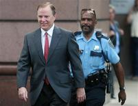 Former Enron Chief Executive Officer Jeff Skilling (L) crosses the street with police escort as he arrives at Federal court in Houston, Texas, in this April 18, 2006 file photo. REUTERS/Richard Carson/Files