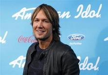"Country singer and judge Keith Urban poses at the party for the finalists of the television show ""American Idol"" in Los Angeles, California March 7, 2013. REUTERS/Mario Anzuoni"