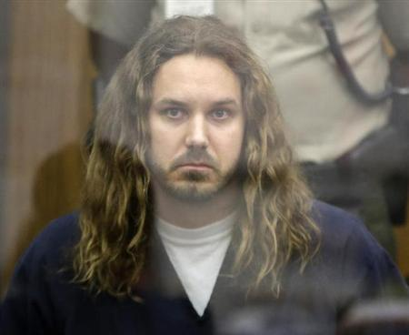 Tim Lambesis, lead singer for the heavy metal band As I Lay Dying, looks on during his arraignment in San Diego North County court in Vista, California May 9, 2013. REUTERS/Lenny Ignelzi/Pool