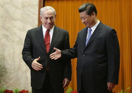 China's President Xi Jinping (R) shakes hands with Israel's Prime Minister Benjamin Netanyahu at the Great Hall of the People in Beijing May 9, 2013. REUTERS/Kim Kyung-Hoon