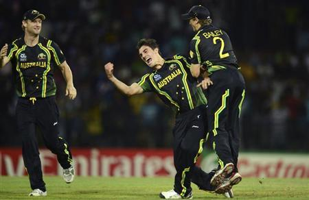 Australia's Pat Cummins celebrates with teammates George Bailey (R) and Cameron White (L) after the dismissal of India's Virat Kohli during the ICC World Twenty20 Super 8 cricket match at the R Premadasa Stadium in Colombo September 28, 2012. REUTERS/Philip Brown/Files