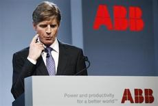 ABB's Chief Executive Officer Joe Hogan gestures while attending the company's annual news conference in Zurich February 14, 2013. REUTERS/Michael Buholzer