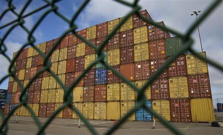 Containers are seen in a dockyard at Southampton Docks in southern England April 23, 2013. REUTERS/Eddie Keogh
