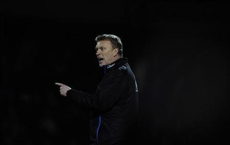 Everton's manager David Moyes gestures during their FA Cup match against Scunthorpe United at Scunthorpe, northern England January 8, 2011. REUTERS/Nigel Roddis