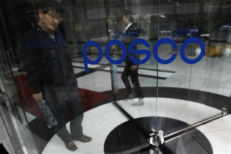 A man exits through a revolving door at POSCO's headquarters in Seoul April 22, 2011. REUTERS/Truth Leem/Files