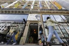 "People walk past the entrance of the 59 Rivoli ""aftersquat"" building in Paris April 9, 2013. REUTERS/Jacky Naegelen"