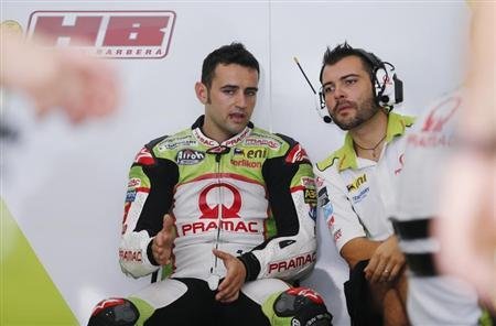 MotoGP rider Hector Barbera of Spain (L) speaks to his mechanic during a free practice session ahead of the Malaysian Grand Prix in Sepang October 20, 2012. REUTERS/Bazuki Muhammad