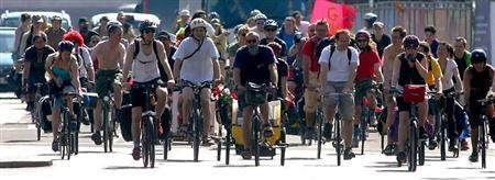 Cyclists ride through central London on their way to Scotland as part of a protest against the G8 Summit, June 19, 2005. REUTERS/Mike Finn-Kelcey
