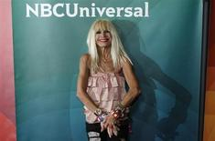 "Fashion designer Betsey Johnson, co-host of ""XOX Betsey Johnson"", arrives at the 2013 NBCUniversal Summer Press Day at The Langham Huntington Hotel and Spa in Pasadena, California, April 22, 2013. REUTERS/Jonathan Alcorn"