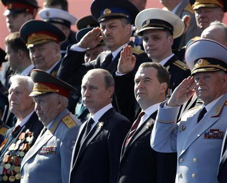 Russian President Vladimir Putin (3rd R) and Prime Minister Dmitry Medvedev (2nd R) watch the Victory Parade on Moscow's Red Square May 9, 2013. REUTERS/Sergei Karpukhin