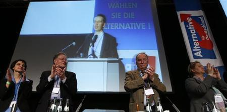 Bernd Lucke, professor of macroeconomics and co-founder of Germany's anti-euro party ''Alternative fuer Deutschland'' (Alternative for Germany) is pictured on a video screen as party fellows Frauke Petry (L-R), Konrad Adam, Alexander Gauland and Dagmar Metzger applaud during the first party congress in Berlin April 14, 2013. REUTERS/Fabrizio Bensch