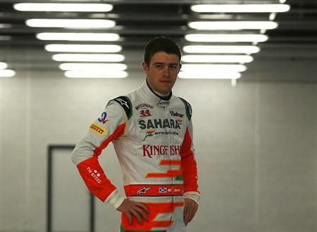 Force India Formula One driver Paul Di Resta of Britain poses for photographers during the launch of the VJM06 car at the Silverstone Race circuit, central England February 1, 2013. REUTERS/Darren Staples