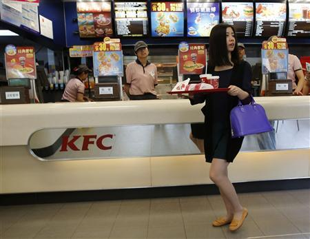 A woman holds food inside a KFC restaurant in Beijing, May 9, 2013. REUTERS/Kim Kyung-Hoon