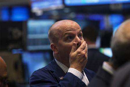 A trader looks up as the trading day ends on the floor of the New York Stock Exchange, May 9, 2013. REUTERS/Lucas Jackson