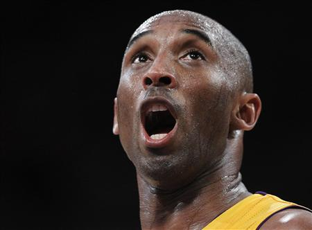 Los Angeles Lakers shooting guard Kobe Bryant yells out in the 4th quarter against the Denver Nuggets during Game 5 of their first round NBA Western Conference basketball playoff game in Los Angeles, California, in this May 8, 2012 file photo. U.S. District Court judge granted a temporary restraining order May 10, 2013 that blocks a New Jersey auction house from selling off Bryant's original jerseys, championship rings and other memorabilia valued at up to $1 million. REUTERS/Lucy Nicholson/Files