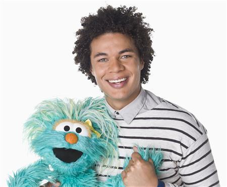 Puerto Rican actor Ismael Cruz Cordova, 26, of ''Sesame Street,'' poses with muppet Rosita in New York in this undated handout photo. Sesame Workshop/Handout via Reuters