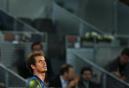 Andy Murray of Britain reacts during his men's singles quarterfinal match against Tomas Berdych of the Czech Republic at the Madrid Open tennis tournament, May 10, 2013. REUTERS/Juan Medina