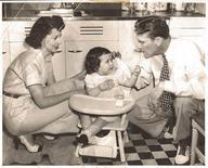 """Baseball player Fritz Ostermueller is pictured with his wife Faye and daughter in this 1948 family photo released to Reuters by his daughter Sherrill Duesterhaus (C). Ostermueller, threw the pitch, but it did not hit Jackie Robinson, the first black man to play major league baseball, in the head and there is no evidence he uttered, """"You don't belong here and you never will,"""" as shown in """"42,"""" the Warner Bros. Pictures film that opened in April. REUTERS/Sherrill Duesterhaus/Handout via Reuters"""