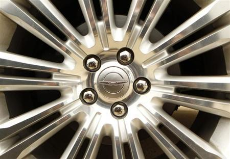 A Chrysler logo is seen on the wheel of a new car at a dealership in Vienna, Virginia April 26, 2012. REUTERS/Kevin Lamarque/Files