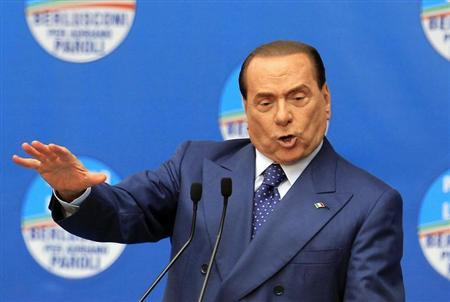 People of Freedom party member Silvio Berlusconi makes an address on stage in Brescia May 11, 2013. REUTERS/Alessandro Garofalo