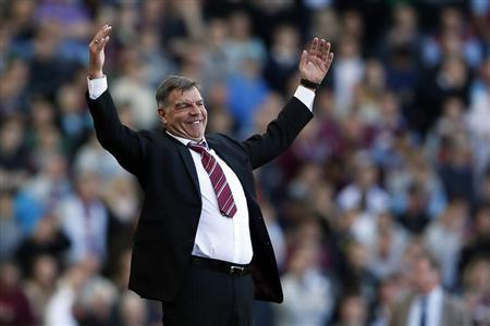 West Ham United's manager Sam Allardyce (L) reacts during their English Premier League soccer match against Newcastle United at The Boleyn Ground in London May 4, 2013. REUTERS/Stefan Wermuth/Files