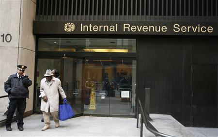 A man walks out of an Internal Revenue Services office after filing his taxes on Tax Day in New York, April 15, 2009. REUTERS/Lucas Jackson