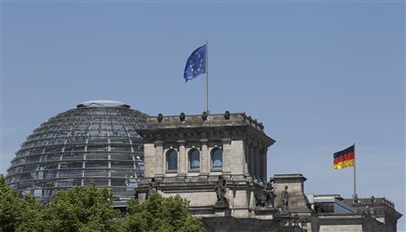 The EU and the German national flag are set up atop the Reichstag building, seat of the German lower house of parliament Bundestag in Berlin, May 26, 2011. REUTERS/Tobias Schwarz