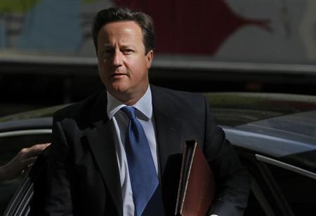 Prime Minister David Cameron arrives at the Global Investment Conference in London May 9, 2013. REUTERS/Andrew Winning