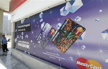 A sign displaying ATM prepaid cards is seen at a RAKBANK branch at Dubai Marina in Dubai May 12, 2013. REUTERS/Ahmed Jadallah