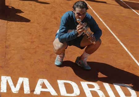 Rafael Nadal of Spain poses with the Ion Tiriac's trophy after winning the Madrid Open final tennis match against Stanislas Wawrinka of Switzerland in Madrid, May 12, 2013. REUTERS/Juan Medina