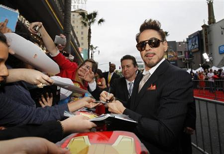Cast member Robert Downey Jr. signs autographs at the premiere of 'Iron Man 3' at El Capitan theatre in Hollywood, California April 24, 2013. REUTERS/Mario Anzuoni/Files