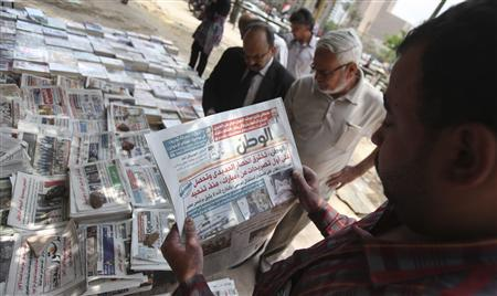 A man reads El-Watan newspaper at Tahrir square in Cairo, May 12, 2013. REUTERS/Mohamed Abd El Ghany