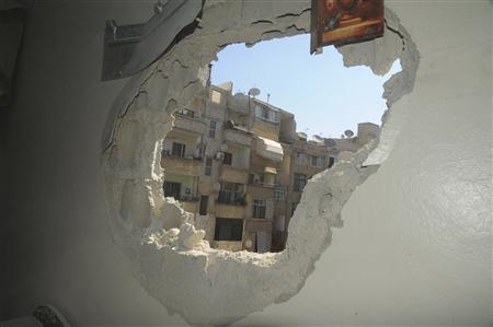 A view shows the damage of a house after mortar bombs landed on the Mezze area in Damascus May 12, 2013, wounding a number of citizens, state media said, in this handout photograph distributed by Syria's national news agency SANA. SANA/Handout via Reuters