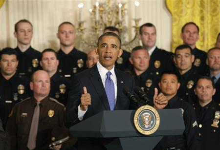 U.S. President Barack Obama honors the 2013 National Association of Police Organizations (NAPO) TOP COPS award winners at the White House in Washington May 11, 2013. REUTERS/Yuri Gripas